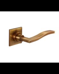 Aldaba deurkruk lichte brons vierkante roset